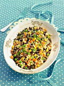 Semolina with peas, sweet corn, carrots and black beans