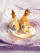 Fig purses with creamy dried fruit sauce