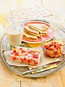 Sweet pancakes, milkshake and strawberry-peach jelly