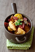 Pan-fried potatoes, ceps and gizzards