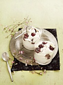 Whipped cream with grapes, honey and poppyseeds