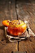 Pumpkin soufflé served in a pumpkin skin
