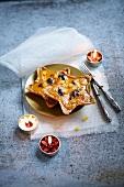 Pumpkin, orange and prune star-shaped pies