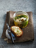 Goat's cheese marinated in oil with herbs on toast
