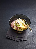 Fennel, apple and red onion salad with lemon and olive oil