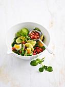 Watercress, potato, hard-boiled egg and cherry tomato salad