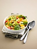 Farfalle, romanesco cabbage, spinach, carrot and tomato salad