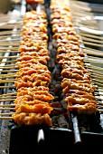 Grilling pork sate brochettes