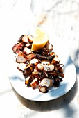 Octopus grilled on a wood fire with lemon