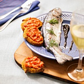 Oven-baked trout and tomato tapenade canapés