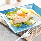 Pan-fried swordfish and thinly sliced stiped green tomatoes