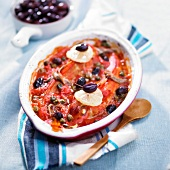 Red millet with tomatoes, olives and capers