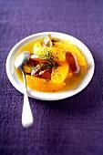Orange fruit salad with dates and green tea