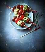 Cherry tomato,mozzarella and chorizo skewers with chives