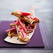 Mustard, boiled ham, emmental and preserved tomato open sandwiches