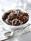 Prunes poached in a star anise infusion with orange zests