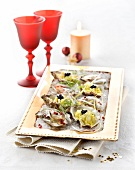 Oysters in Champagne aspic with pink peppercorns, thinly sliced creamy leeks and lumpfish roe