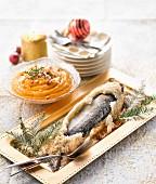 Wolfsbarsch in Salzkruste, Butternusskürbispüree mit Haselnüssen