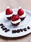 Pere Noel writter in chocolate letters and chocolate fondant,strawberry and whipped cream bites