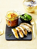 Free-range chicken supreme and a jar of zucchini gratin