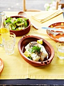 Stemed cod with rosemary and lemon juice, artichoke salad