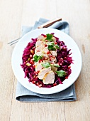 Pork filet mignon with pan-fried red cabbage,pomegranate seeds and celery stalks