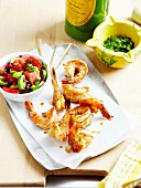 Crisp shrimps marinated in soya sauce and garlic.cucumber,tomato,watermelon and pomegranate salad