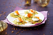Small potato galettes with poached eggs and salmon