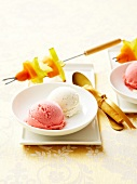 Plate of guava and vanilla ice cream with exotic fruit brochettes