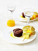 Small chocolate fondante and exotic fruit brochettes