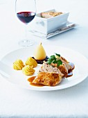 Chicken supreme duo with gravy,Duchesse potatoes,poached pears and cherry jam