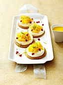 Faiselle tartlets topped with mango,pomegranate,lime and pistachio