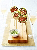 Lollipop-style pesto,cream cheese and smoked trout appetizers