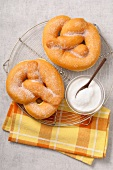 Bretzel-shaped sugar fritters
