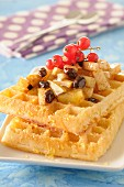 Waffles with redcurrants,raisins,pear,honey and cinnamon