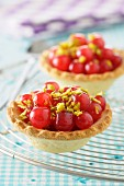 Redcurrant and crushed pistachio tartlets