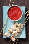 Raspberry-lychee soup and roast marshmallow brochettes
