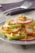 Thinly sliced apples with honey and walnuts