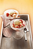 Vanilla ice cream, small french meringue and strawberry puree sundaes
