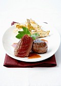 Medium-cooked noisettes fillet of venison and pan-fried slices of celeriac