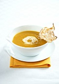 Cream soup of old-fashioned vegetables and root celeriac crisps