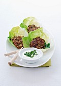 Veal patties served in lettuce leaves, creamy mint sauce