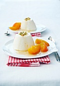 Panacotta with honey,stewed apricots and crushed pistachios