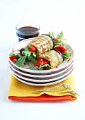 Stewed eggplant,red pepper and rocket lettuce rolls