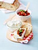 Ricotta and goat's cheese on sliced bread, roasted and sun-dried tomato salsa
