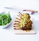 Rack of lamb in mustard and parsley crust with green spring vegetables