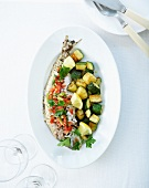 Sea bass in virgin sauce and pan-fried zucchinis