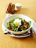 Rocket lettuce, mushroom and pine nut salad garnished with a poached egg