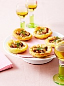 Gruyère,fig and chopped raw ham tartlets