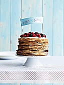 Stack of pancakes with mascarpone and summer fruit